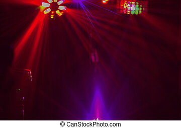 Lighting disco with bright beams of searchlight and laser show.