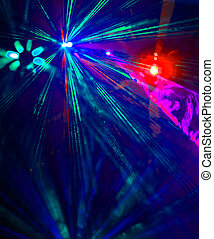 Lighting disco with bright beams of searchlight, laser show.