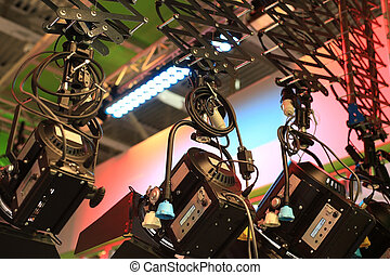 Lighting equipment hang from the ceiling in a television ...