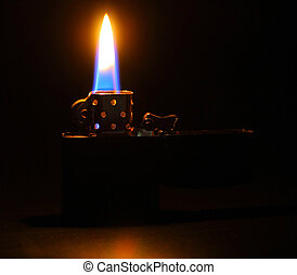 Lighting flame on dark background