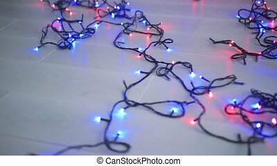 Lighting garland on floor - Composed black garland with...
