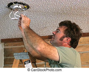 Lighting Installation 1 - an electrician installing an ...