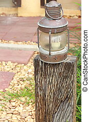 Lighting lamp on a wooden pole.