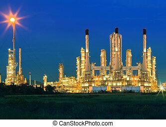 lighting of oil refinery palnt against dusky blue sky of oil re