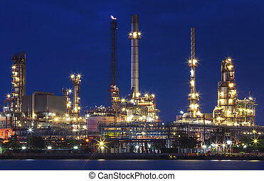 lighting of oil refinery plant in heavy industry estate against