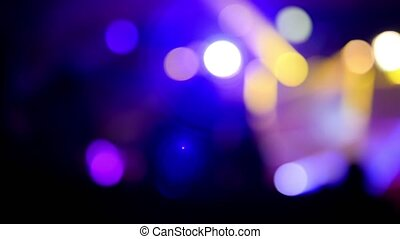 Lighting on stage at a rock concert, blurred background
