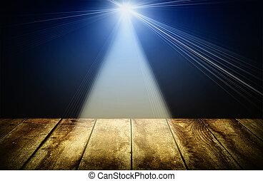 lighting over dark background and wood floor