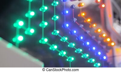 Lighting status indicator signals on electric control panel of automation machine equipment on fabric, exhibition - close up view. Industrial, manufacturing, electronic and technology concept