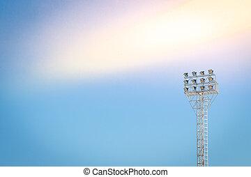 Lighting tower of stadium on sky background