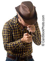Lighting up - cowboy lighting a cigarette