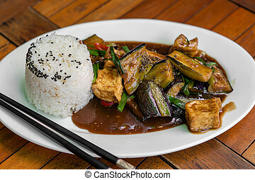 Lightly fried tofu and stew with eggplant, onion, garlic, ...