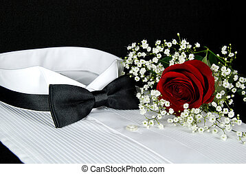 Lightly Starched - Red rose on a tuxedo shirt.