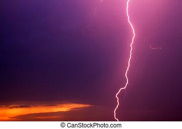 Lightning against dark cloudy sky