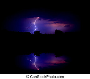 Lightning bolt at night on a lakeshore
