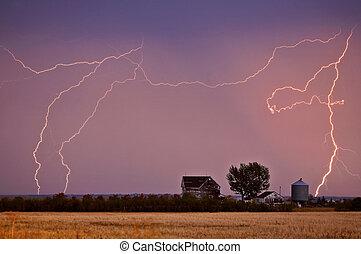 Lightning bolts seen behind Saskatchewan farmyard