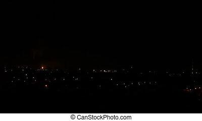 Lightning City - Lightning storm over city at night.