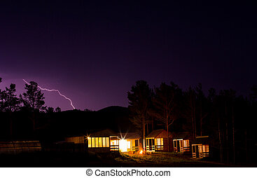 Lightning in the night sky over houses