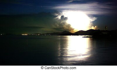 Lightning in the sea during night time. Time lapse -...