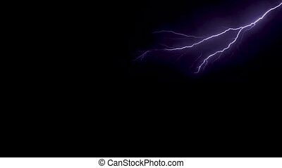 Lightning in the sky at night shot with long exposure -...