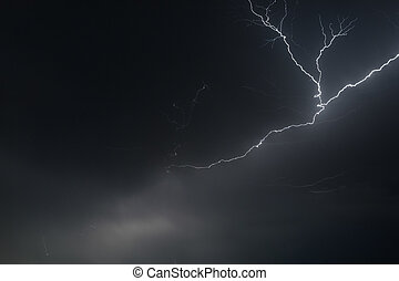 Lightning in the thunderstorm cloudy sky