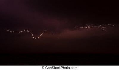 Lightning on the sky over the ocean