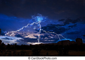 Lightning over city - Lightning and storm clouds over the...