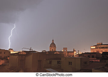 lightning over urban houses in Palermo