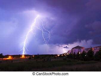 lightning on a thunderstorm in a park with cloudy sky