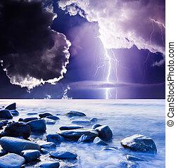 lightning - Dark ominous clouds. Summer storm beginning with...