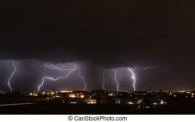 Lightning storm over city - Severe lightning storm over a...