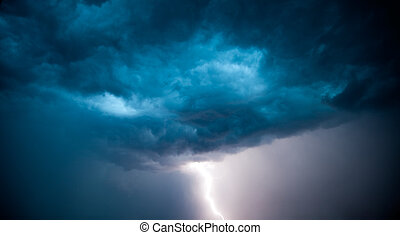 lightning strike and dark storm clouds in sky