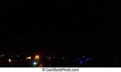 Lightning strikes the sky at night in city - Lightning...