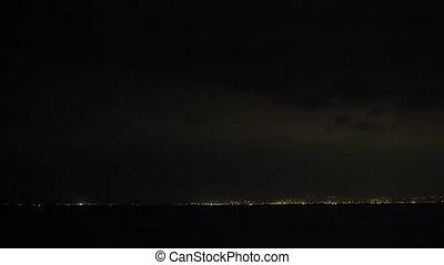 Lightnings in night sky over the city