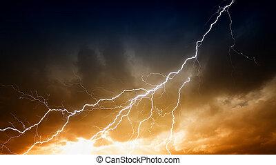 Lightnings in sunset sky