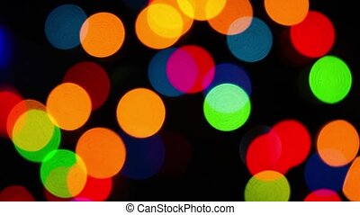 Lights garlands, abstract background. Bokeh effect. Christmas tree lights twinkling. Winter Holidays footage.