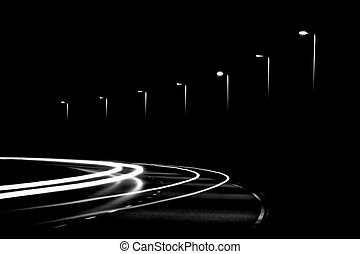 Light trails and streetlights in the night. Black and White