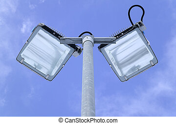 Lights in the sky - Looking up at floodlights on a...