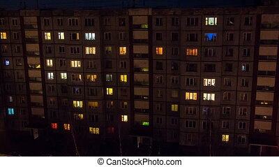 Lights in the windows of house building