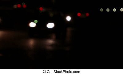 Lights of cars slow moving in the dark. Modern city night traffic