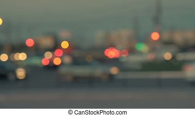 Lights of the night city. Blurred background. Silhouettes of cars. Nightlife teal-orange bokeh.