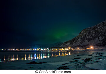 Lights of the Village are Reflected in the Night Fjord