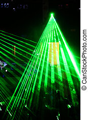 Lightshow - a lightshow with a green laser lights within a...