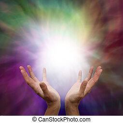 Lightworker Sending Healing Energy - Healer's hands open and...
