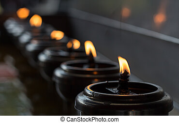 Lignting of Praying candles in a temple