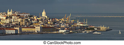Aerial panorama of Lisbon old city center at sunset, view from Almada, Portugal