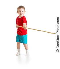 Liitle boy pulling rope isolated on white