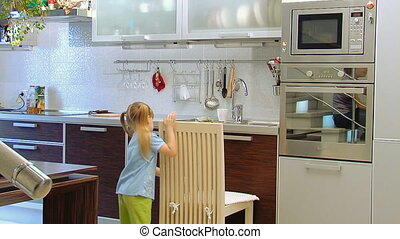 Liitle girl in kitchen