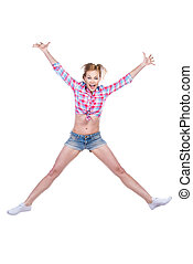 Like a star. Full length of attractive young woman in funky wear stretching out her arms and legs while jumping against white background