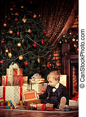 like fairytale - Little boy playing with toys at home near...