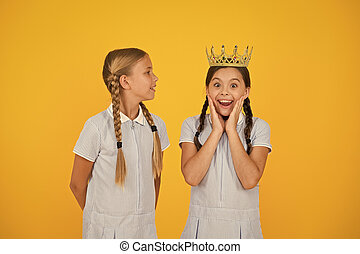 Like never before. small egoist girls imagine they are princess. success reward. happy childhood frienship. prom queen. retro selfish kids. vintage girls in gold crown. motivation to be the best